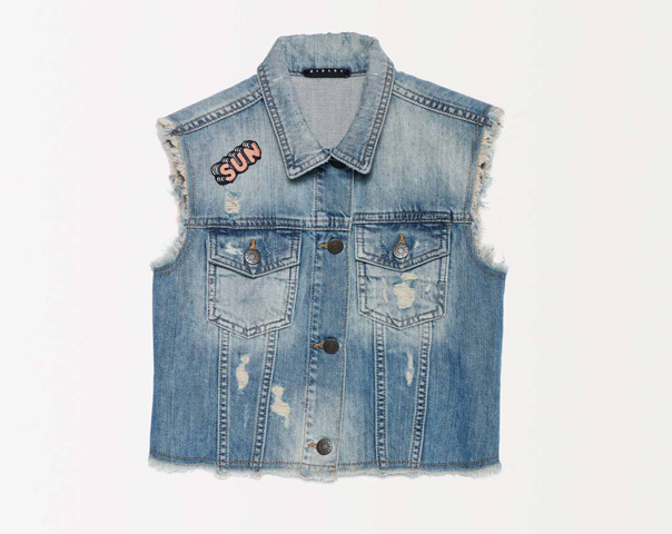 Denim vest with rips and patch